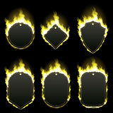 Set of six frames surrounded with yellow flame. Set of six frames of different shapes with text space surrounded with realistic yellow flame isolated on black Stock Photos