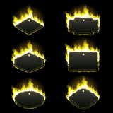 Set of six frames surrounded with yellow flame. Set of six frames of different shapes with text space surrounded with realistic yellow flame isolated on black Royalty Free Stock Photography