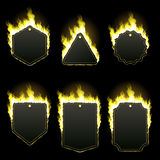 Set of six frames surrounded with yellow flame. Set of six frames of different shapes with text space surrounded with realistic yellow flame isolated on black Royalty Free Stock Image