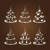 Set of six glass tags in the form of a Christmas tree. On a brown background Stock Image