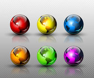 Set of six glossy colored Earth globes Stock Photos