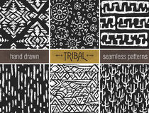 Set of six hand drawn tribal seamless black and whitepatterns. Stock Photo