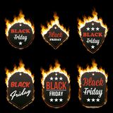 Set of six hot BLACK FRIDAY tags in flames. Set of six hot BLACK FRIDAY tags of different shapes surrounded with realistic flame isolated on black background Stock Photos