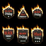 Set of six hot BLACK FRIDAY tags in flames. Set of six hot BLACK FRIDAY tags of different shapes surrounded with realistic flame isolated on black background Royalty Free Stock Photography