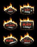 Set of six hot BLACK FRIDAY tags in flames. Set of six hot BLACK FRIDAY tags of different shapes surrounded with realistic flame isolated on black background Royalty Free Stock Image
