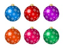 Set of six multicolored Christmas balls with snowflake decoration Royalty Free Stock Image