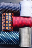 Set of six multicolored rolled up males ties. View from above royalty free stock image