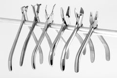 A set of six orthodontic pliers Stock Photo
