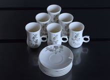 Set of six porcelain cups of coffee Stock Photos