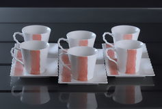 Set of six porcelain cups of coffee Royalty Free Stock Photography