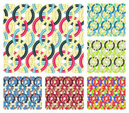 Entwined rings. Seamless patterns. Set of six seamless patterns that consist of multicolored entwined rings Stock Image