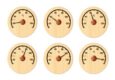 Set from six wooden thermometers. For a sauna, showing different temperature  Isolated on a white background Stock Photos