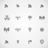 Set of sixteen different black vector wireless and wifi icons Royalty Free Stock Image