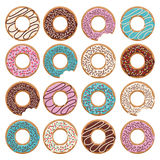 Set of sixteen  glazed donuts. With blue, blue and chocolate cream Stock Photos