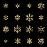 Set of sixteen shine relief golden snowflakes isolated on black background. New Year and Christmas card glittering vector illustration