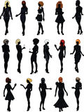 Set of sixteen silhouettes in black cocktail dress Stock Photos