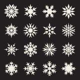 Set of Sixteen Symmetrical White Snowflakes Design on Black Background Stock Photos