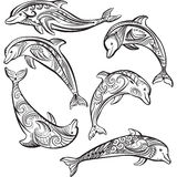 Set of Sketch of Decorated dolphin. Set of Sketch of black Decorated dolphin Stock Images
