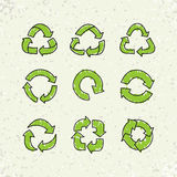 Set of sketch doodle vector recycle reuse symbol  on craft paper background. Set of sketch doodle recycle reuse symbols  on craft paper background. Hand drawn Royalty Free Stock Photo