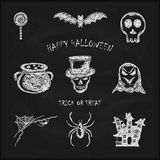 Set of sketches Halloween icons on black chalkboard Stock Photo