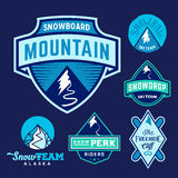 Set of Ski Snowboard Snow Mountains Sport Logos or Vintage Labels, Colorful on Blue Background Royalty Free Stock Image