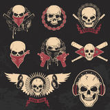 Set of skulls emblems. T-shirt print templates. Dj skull, biker skull, skull with blades. Design templates and elements Stock Photography