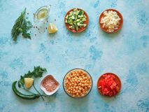 Set of sliced vegetables and chickpeas on a blue background with copy space. Set of sliced vegetables and chickpeas on a blue background with copy space Royalty Free Stock Image