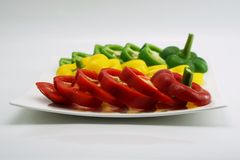 Set of slightly cut sweet pepper on dish 1 Royalty Free Stock Photo