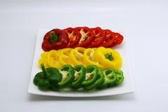 Set of slightly cut sweet pepper on dish 3 Stock Image