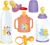 Set of small bottles. And a dummy for the kid Royalty Free Stock Image