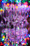 Set of small crystal liqueur glasses on background of colorful l. Set of small crystal liqueur glasses Royalty Free Stock Image