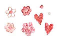 Set of small decorative embroidered flowers, hearts and beads Stock Photos