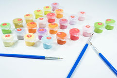 Set of small paint bucket for painting. And paint brushes Royalty Free Stock Photography