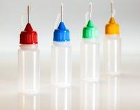 Set of small plastic sample bottles for liquids Stock Image