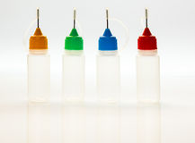 Set of small plastic sample bottles for liquids Royalty Free Stock Photo