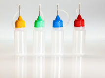 Set of small plastic sample bottles for liquids Royalty Free Stock Photography