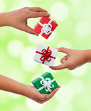Set of small presents in child hands Stock Photo