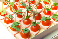 Set of small snacks canape with cherry tomatoes, cheese and ham Royalty Free Stock Images
