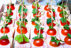 Set of small snacks canape with cherry tomatoes, cheese and ham Stock Photo