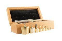 Set of small weights for weighing in a wooden box. Royalty Free Stock Photography