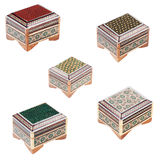 Set of the small wooden decorated caskets. Stock Images