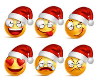 Set of Smiley face of santa claus yellow emoticons with facial expressions and christmas hat. In glossy 3D realistic isolated in white background. Vector Royalty Free Stock Photos