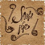 Set of smoke pipes, lettering smoke pipes on a craft paper Stock Images