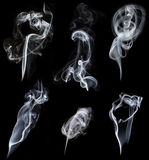 Set of smokes on black background Stock Photography