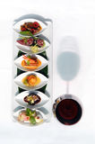 Set of snack and red wine glass Royalty Free Stock Image