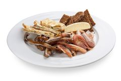 A set of snacks for beer. Pork ears, shrimps, pita bread with cheese stock photos