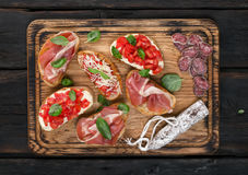 Set snacks for wine is served on wooden board Stock Photo