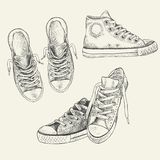 Set of sneakers on the white background drawn in a sketch style. Gumshoes. Description: Each drawing comprise of one color royalty free illustration
