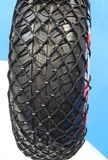 Set of Snow Chains. Set of Snow Chains Fitted to a Heavy Duty Vehicle Tyre royalty free stock images