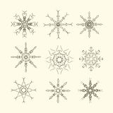 Set of snow-flakes line icons, black and white sketches on light pink Stock Photography
